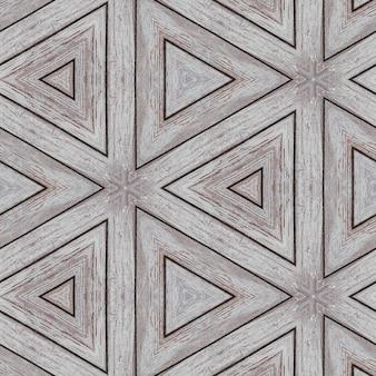 三角形と線の形の木製の板の例示的なパターン。