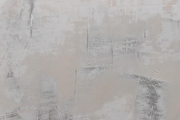 パテ壁の背景。乾式壁の壁に漆喰。