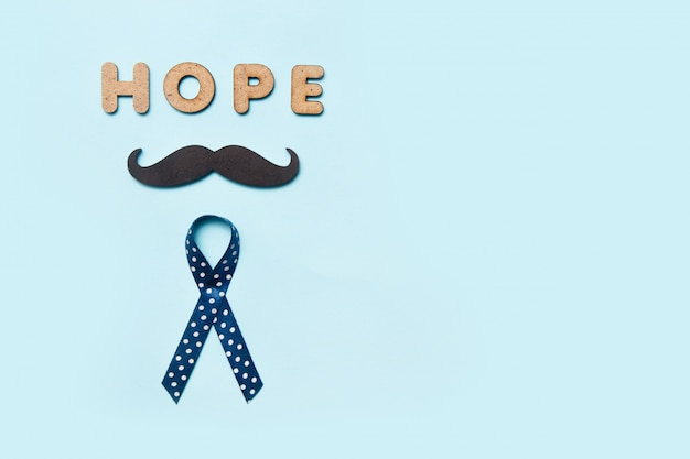 口ひげと言葉の希望と青いリボン
