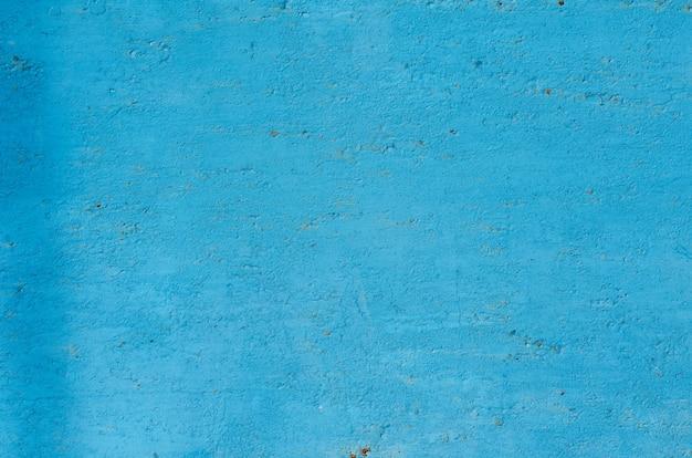 ペイントの多くの層を持つヴィンテージの塗られた鉄の壁の背景のテクスチャ