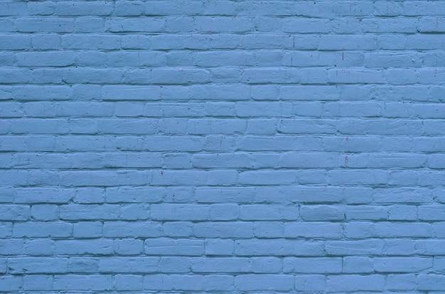 セメントとコンクリートの継ぎ目で古い青いレンガの壁の表面のテクスチャ
