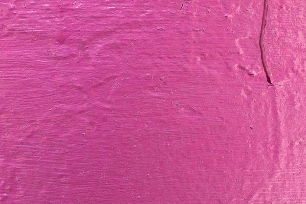 セメント塗装壁の背景、鮮やかなピンク色