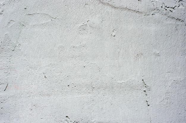 灰色の漆喰の背景に塗られ、塗られた外観、セメントの粗いキャストとコンクリートの壁の質感
