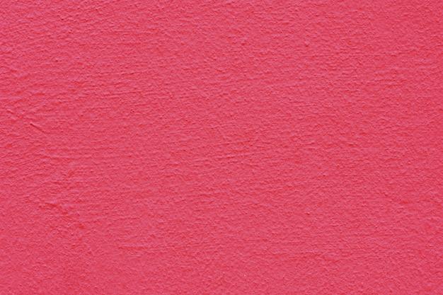 ピンクの漆喰の背景に塗られ、塗られた外観、セメントの粗いキャストとコンクリートの壁の質感