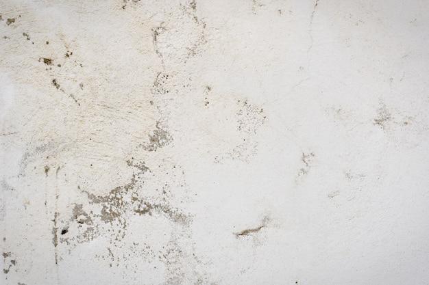 セメントの白い漆喰コーティングおよび塗装外装ラフキャストの背景