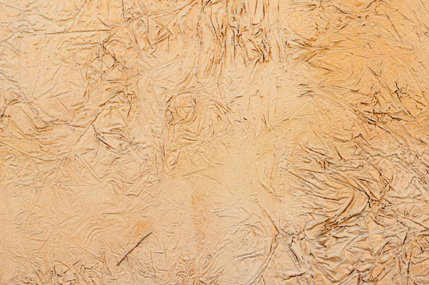 黄色の漆喰でコーティングおよび塗装された外装、セメントの粗いキャストおよびコンクリートの壁のテクスチャ