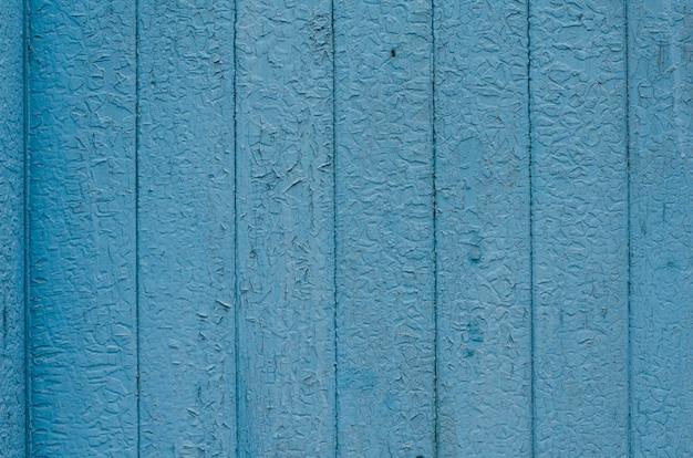 Трещины выветривания зеленой и синей краской деревянная доска текстуры фона