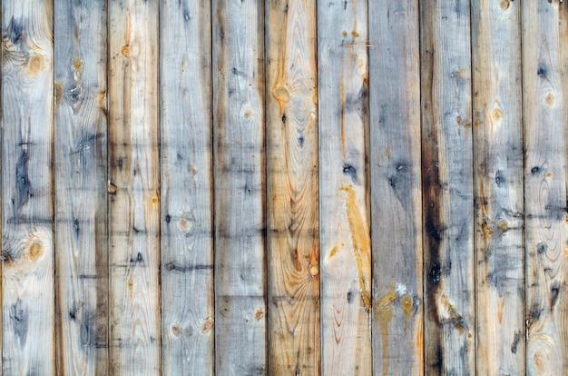 塗料なしのフェンスボードの自然な木製の背景