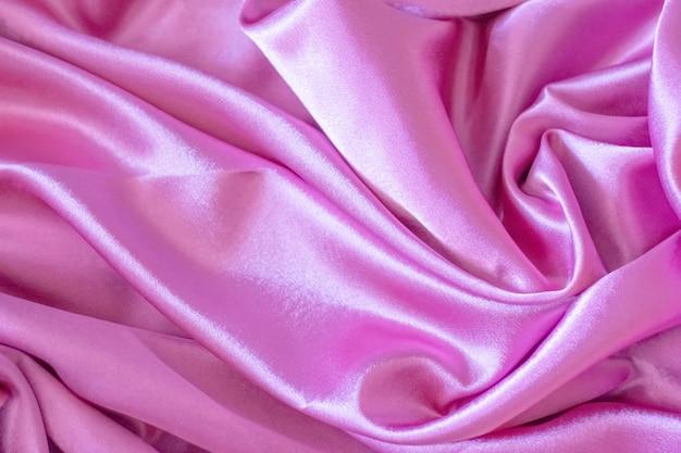 ピンクのエレガントなソフトサテン生地