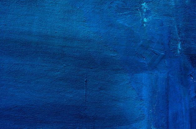 Темно-синяя штукатурка с покрытием и окрашенная стена