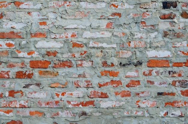 Деревенская винтажная красная кирпичная стена