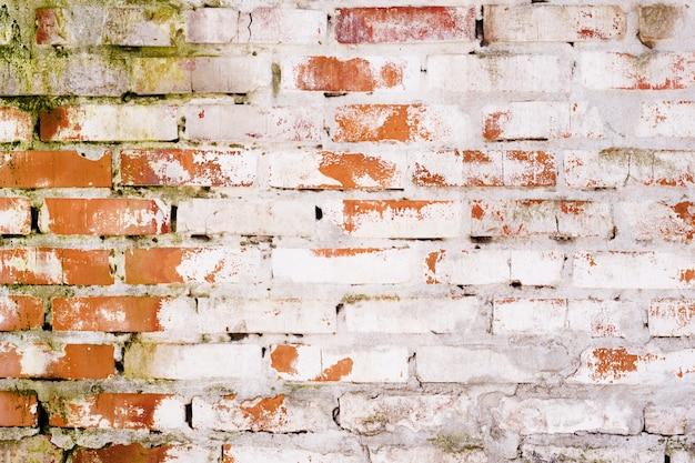 セメントの質感と古いビンテージ赤レンガの壁