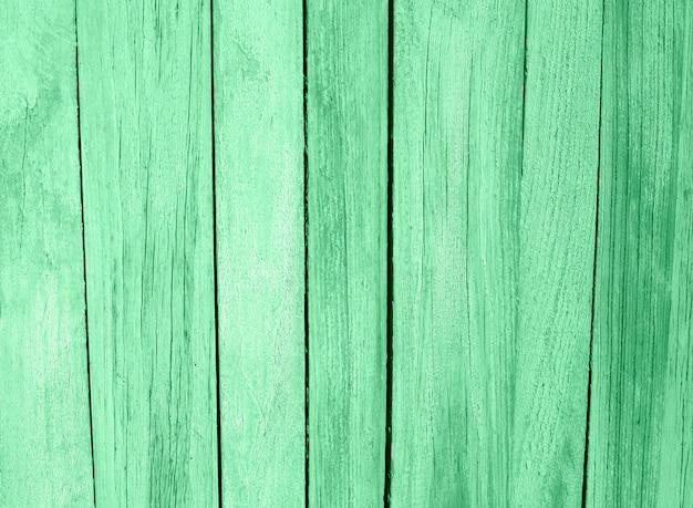 ミント色で塗られた木のテーブルの板のテクスチャ