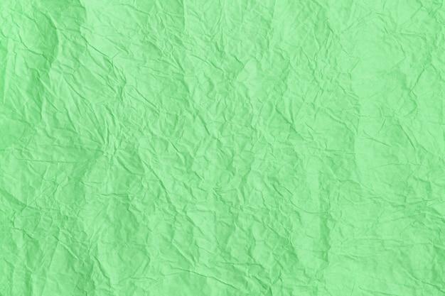 トレンディなミント色のテクスチャ背景、しわくちゃの紙のテクスチャ。