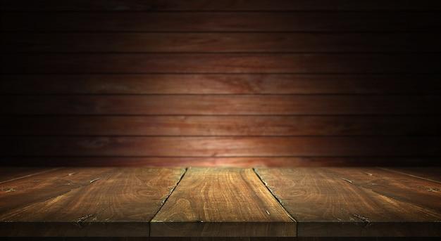 ぼやけた壁の背景に古い木のテーブル