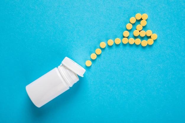 医薬品の薬、錠剤、ボトルにブルー
