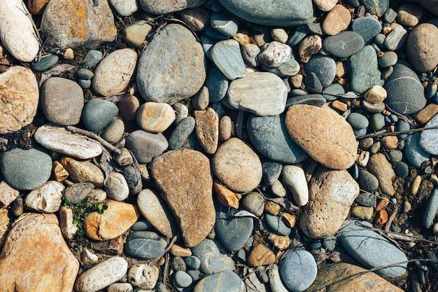 石の質感、トップビュー乾燥ラウンドリーブルパターンと抽象的な背景を閉じる