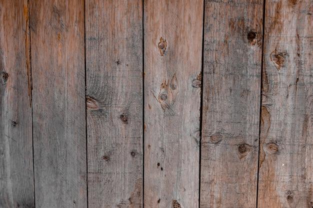 Старые деревянные панели коричневого цвета в качестве фона
