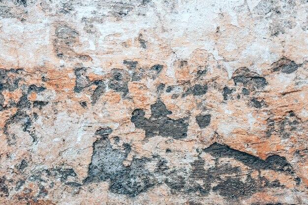 穴とコンクリートの古い壁の背景