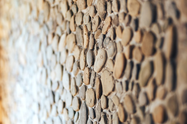 別の丸い石の壁の背景テクスチャ