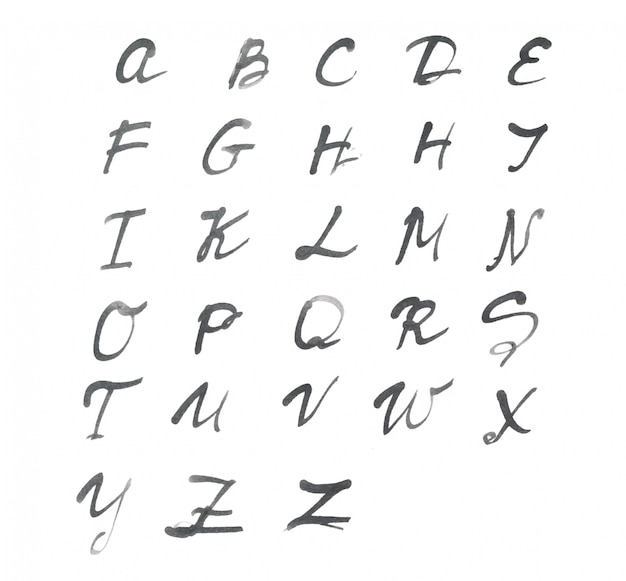 白い紙に書かれたアルファベット