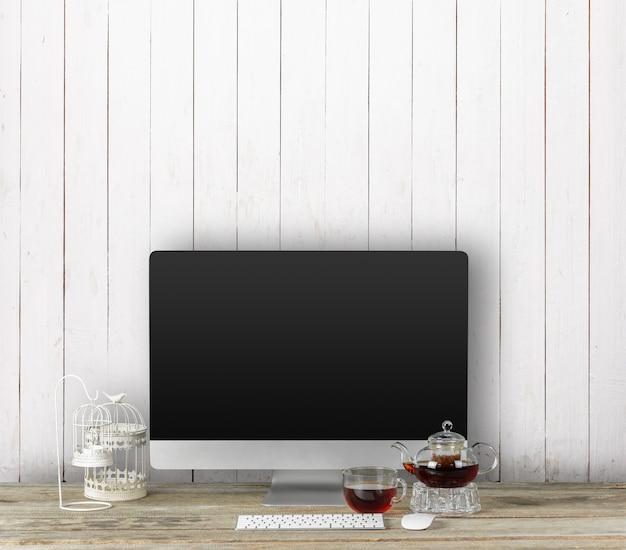 オフィスのインテリアのモックアップのためのコンピューターのディスプレイ。