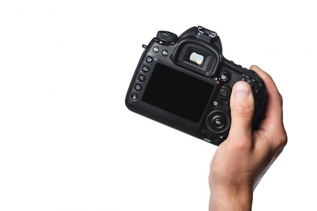 白で隔離される手の写真カメラ