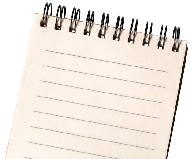 白い背景で隔離された空白のメモ帳