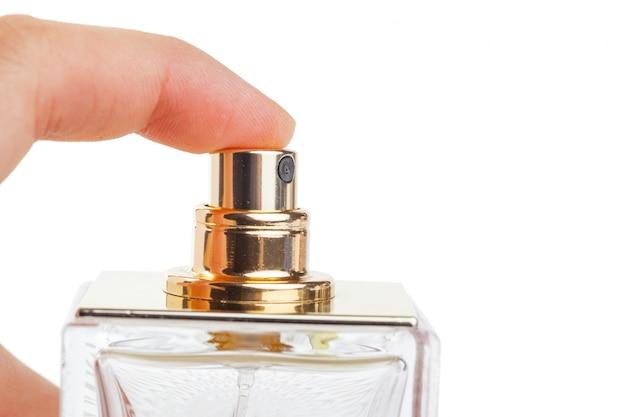 白で隔離される香水瓶