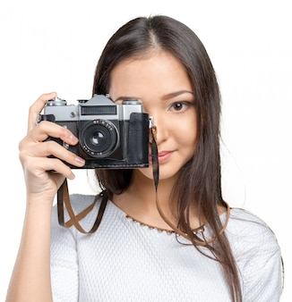 レトロな写真のカメラをしている女の人