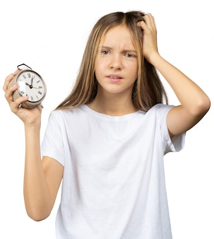 時計、目覚まし時計を持つ少女