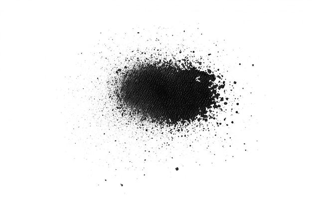 白い紙の上の黒い色のスプレー式塗料