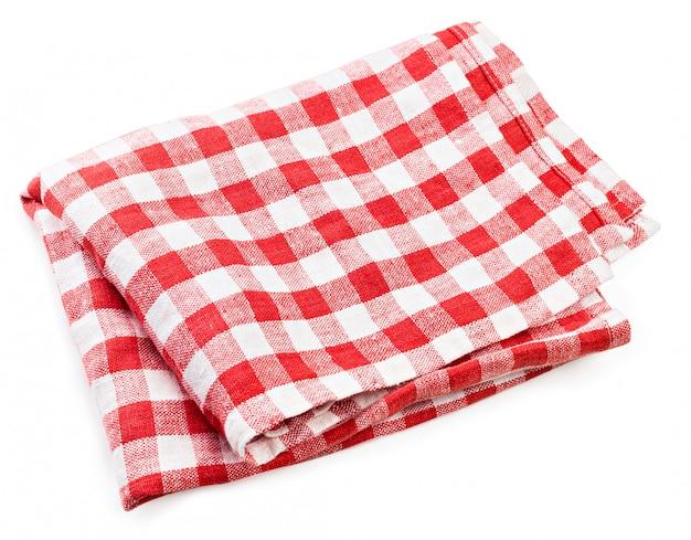 白で隔離赤い折られたテーブルクロス