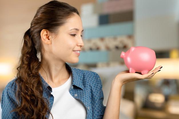 女性持株貯金箱