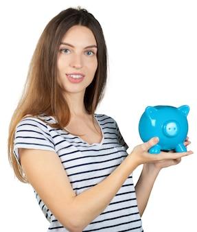 貯金を持つ女性。白い背景で隔離