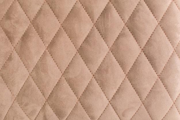 コーチタイプスクリードと布の装飾的な背景