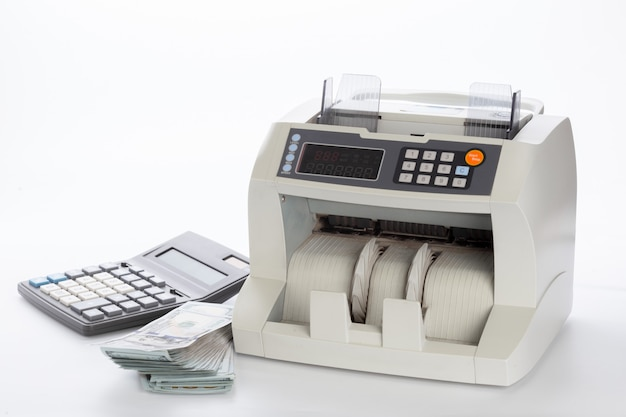 白で隔離されるお金カウンター
