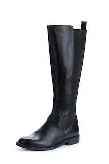 白で隔離される女性の高い膝革ブーツ