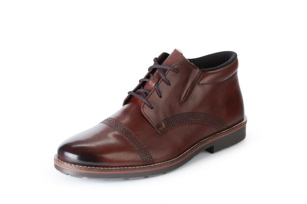 白で隔離される茶色の正式な男性の革の靴