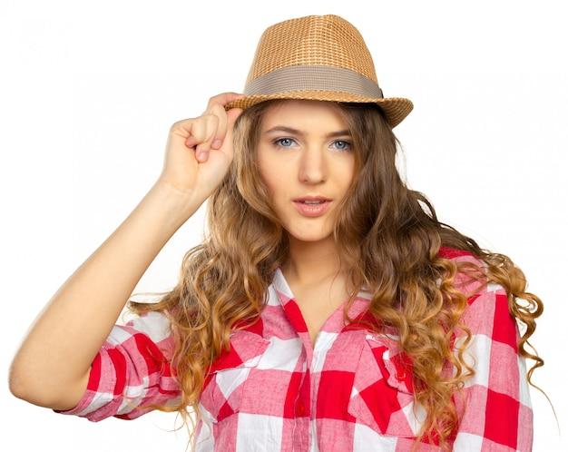 帽子のスリムなかなり若い女の子