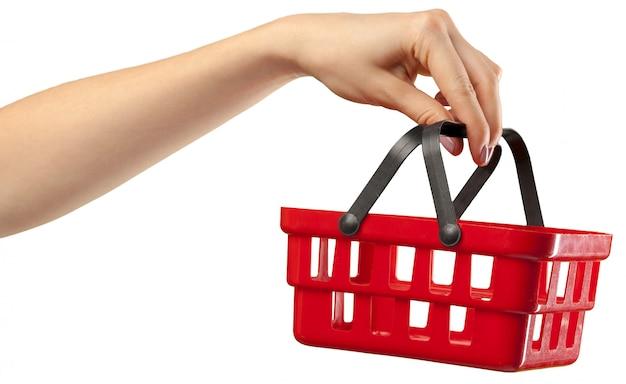 手に買い物カゴ