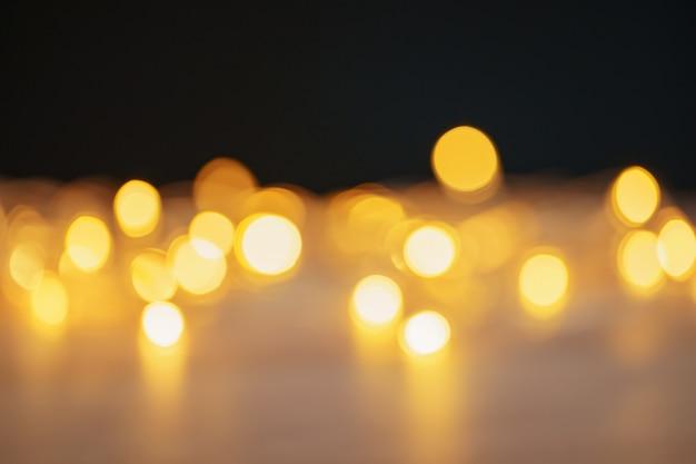 背景としてクリスマスライトボケぼやけた画像