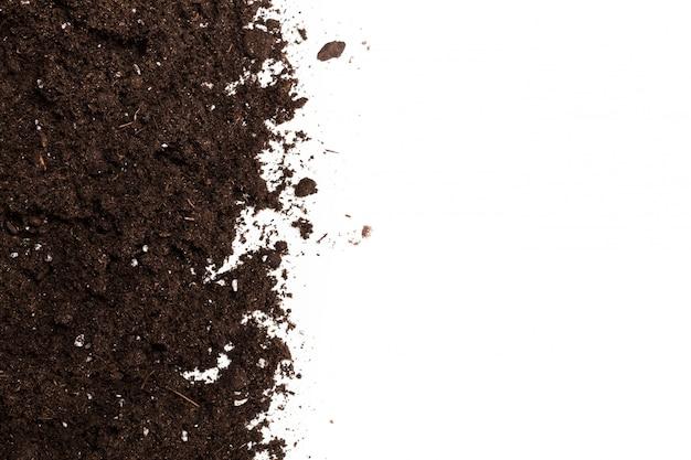 白で隔離される土または土のセクション