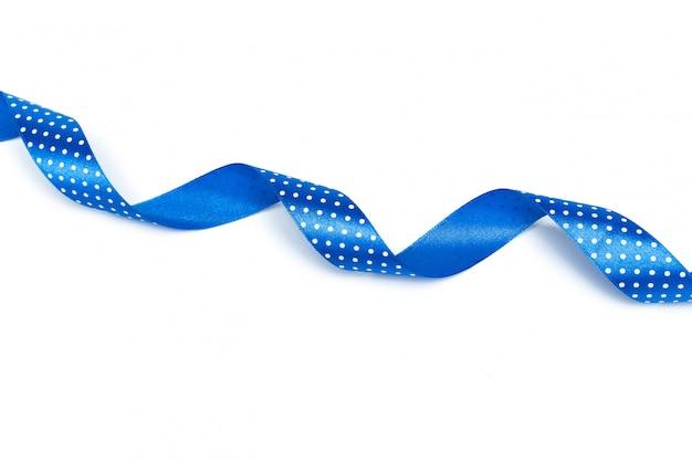 Блестящая голубая лента на белом
