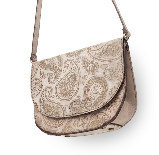 白で隔離される革の女性のハンドバッグ