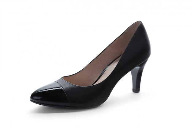 白で隔離される女性のハイヒールの靴