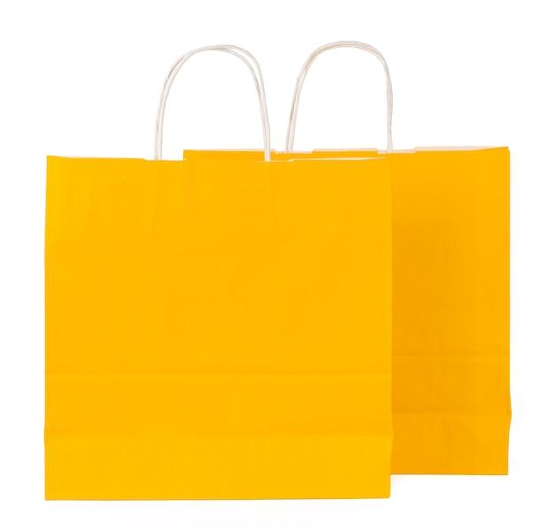 白で隔離される色の買い物袋