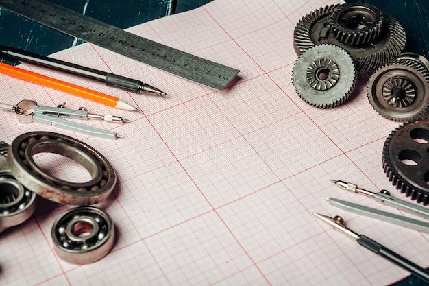グラフ用紙上の車の部品をクローズアップ。エンジニアリングコンセプト