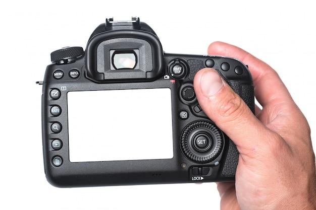 手に写真カメラ