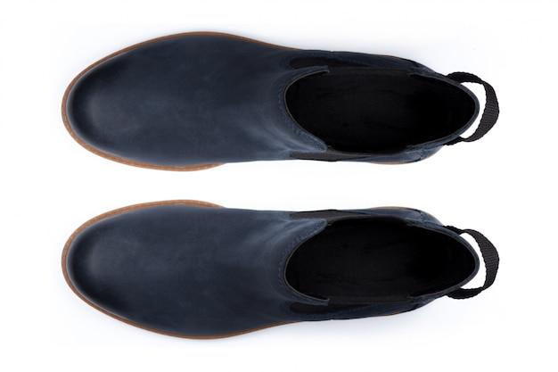 Ботинки изолированные на белой предпосылке. вид сверху.